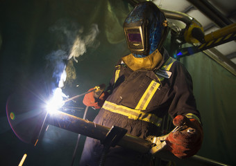 A welder works fabricating an piece of equipment at Sequoia Environmental Remediation a leading environmental supply and service company in Calgary.