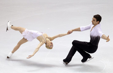 Scimeca and Knierim of the U.S. perform their pairs short program at the ISU World Figure Skating Championships in London