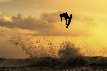 Wakeboarder Getting Air During Sunset Wall mural