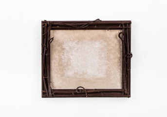 Old, rustic, decorative, wooden frame of twigs on a white background