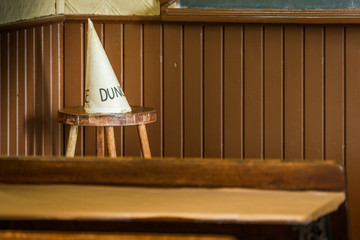 Dunce hat in an old school class.