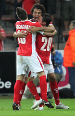 Belhocine of Standard Liege celebrates his goal with team-mates Seijas and Pocognoli during their Europa League soccer match against FC Copenhagen in Liege