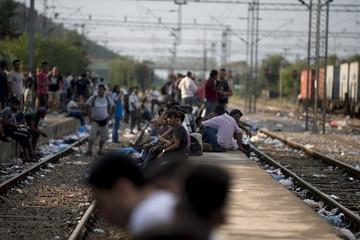 Migrants wait for a train at Gevgelija train station in Macedonia