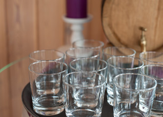 Empty glasses on the background of a wooden barrel