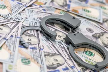 handcuff above usa dollar. close up . - fototapety na wymiar