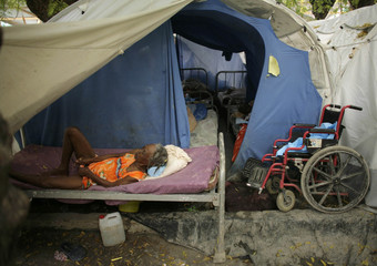 A woman rests in a provisional camp in Port-au-Prince