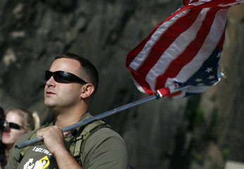 Iraq war veteran Troy Yocum walks across the George Washington Bridge to New York as part of 7,000 mile journey to raise awareness and money for U.S. military families in need