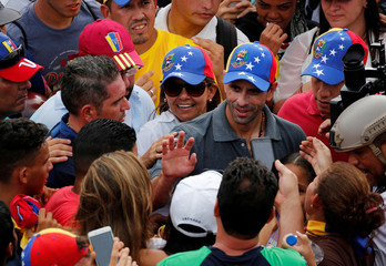 Capriles is cheered by supporters blockade in an avenue while rallying against Maduro in Caracas