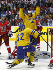 Sweden's Kruger celebrates his goal with team mate Jakob Silfverberg during their semi-final match against the Czech Republic at the Ice Hockey World Championships in Bratislava