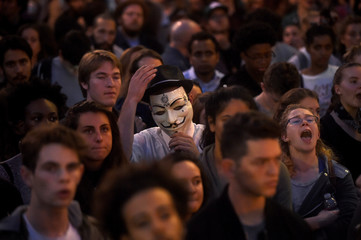 A protester adjusts his Guy Fawkes mask while rallying with protesters in Oakland, California, U.S. following the election of Donald Trump as President of the United States