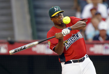 Musician MC Hammer hits a homerun during the Legends and Celebrities All Star softball game at Angel Stadium in Anaheim