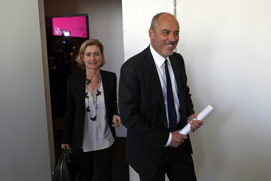 French telecom operator Orange CEO Stephane Richard leaves after the company's 2015 annual results presentation in Paris