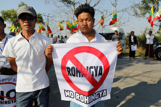 People protest while Malaysian NGO's aid ship carrying food and emergency supplies for Rohingya Muslims arrives at the port in Yangon