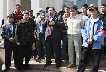 People gather in the centre of Bishkek to protest against looters