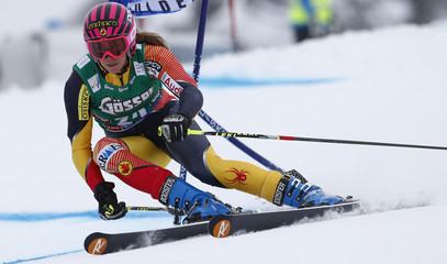 Gagnon of Canada clears a gate during the first run of the women's giant slalom World Cup race on the Rettenbach glacier