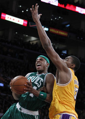 Celtics' Pierce drives to the basket against Lakers' Bynum during their NBA basketball game in Los Angeles