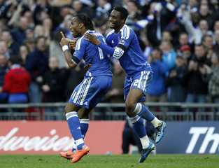 Chelsea's Drogba celebrates with Mikel after scoring during their FA Cup semi-final soccer match against Tottenham Hotspur in London