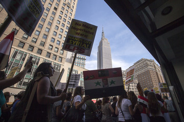 The Empire State Building is seen in the background as anti-war activists march towards Union Square in Manhattan, New York