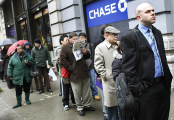 People wait in line to enter the NYCHires Job Fair in New York