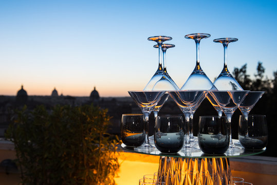 Sundowner cocktail party concept on city skyline