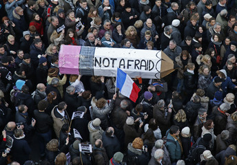 """Citizens carrying a giant cardboard pencil reading """"Not Afraid"""" take part in a Hundreds of thousands of French citizens solidarity march (Marche Republicaine) in the streets of Paris"""