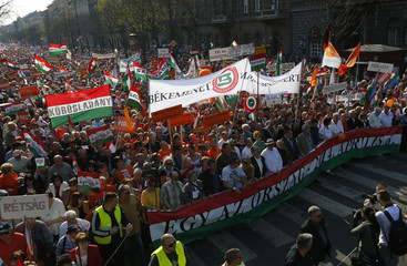 Supporters march during an election rally of Prime Minister Viktor Orban's ruling Fidesz party in Budapest