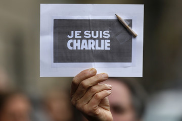 """A person holds a placard with a pencil which reads """"I am Charlie"""" during a minute of silence in Strasbourg for victims of the shooting at the Paris offices of weekly satirical newspaper Charlie Hebdo on Wednesday"""