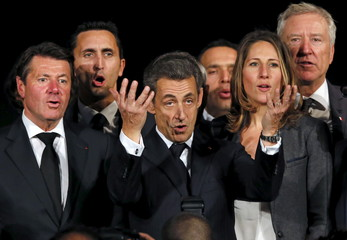 Christian Estrosi and Nicolas Sarkozy sing the national anthem after a political rally for the upcoming regional elections in Avignon