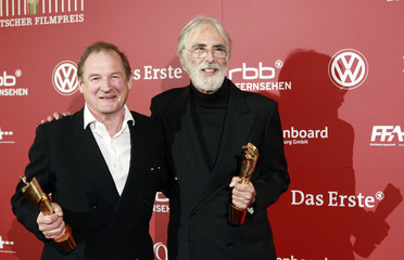 Director Haneke and his cast member Klaussner hold their trophies at the German Film Awards in Berlin