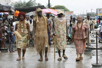 Models dressed in traditional clothes made with raffia, a natural fibre drawn from a palm tree, walk during a fashion show organized by Ivorian designer Genevieve Koukougnon, in Abidjan