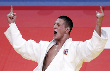 Krpalek of the Czech Republic celebrates winning his under 100kg men's bronze medal bout against Van Der Geest of Belgium at the World Judo Championships in Paris