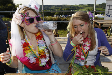 Louise and Lottie Gray, of Bincombe, compete in the annual Nettle Eating World Championships during a hen party at Bottle Inn pub in Marshwood