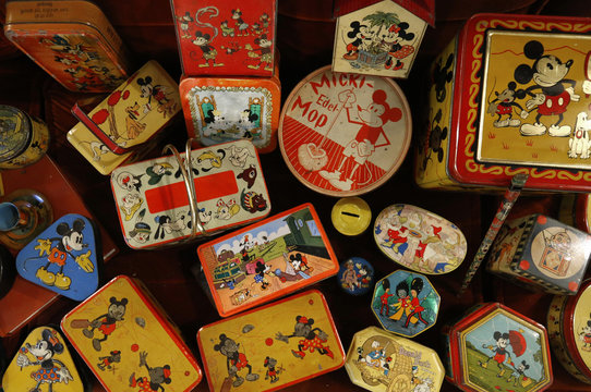 Vintage lithographed tin boxes with images of cartoon characters are displayed at the house of Dardenne in Grand-Hallet
