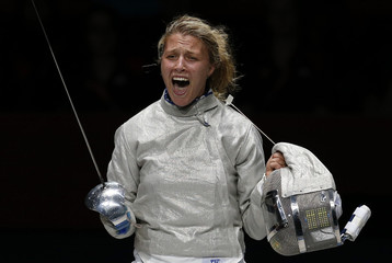 Ukraine's Olga Kharlan celebrates as she wins against Mariel Zagunis of the U.S. at the end of their women's sabre individual bronze medal fencing match at the London 2012 Olympic Games