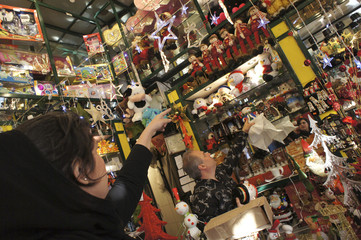 A Christian woman looks towards a Christmas symbol while shopping in central Tehran