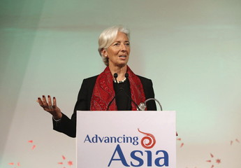 """IMF Managing Director Christine Lagarde addresses the gathering during her closing remarks at the """"Advancing Asia: Investing for the Future"""" conference in New Delhi, India"""