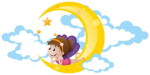 Cute fairy sitting on moon