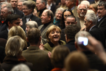 German Chancellor Merkel and Lower Saxony's state governor  McAllister are welcomed by supporters as they arrive at CDU election campaign rally in Stade