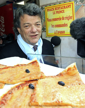 Borloo, French deputy and President of the French Radical Party, leaves a shop selling pizzas after a visit at the memorial of La Marseillaise in Marseille