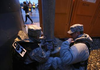 Members of Utah National Guard 85th Civil Support Team use bomb sensing equipment to monitor the Salt Lake City Marathon in Salt Lake City