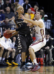 St Bonaventure's Conger passes against  Florida State's Moreau during the second half of their men's NCAA basketball game in Nashville
