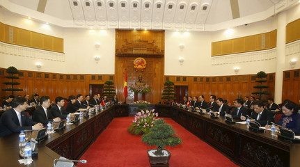 China's Vice Premier Zhang and Vietnam's PM Dung talk during a meeting at the Government Office in Hanoi