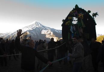 Men carry a religious symbol during Ashura in Nava