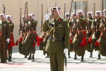The Bedouin honour guard greets Jordan's King Abdullah upon his arrival to the opening of the first session for the new parliament in Amman