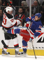 New Jersey Devils' Carter checks New York Rangers' Mitchell during the first period of Game 2 of the NHL Eastern Conference Finals hockey playoffs at Madison Square Garden in New York