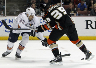 Edmonton Oilers defenseman Jason Strudwick battles for the puck with the Anaheim Ducks left wing Matt Beleskey in the second period of their NHL hockey game in Anaheim
