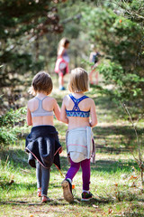 Two girls walking on nature trail