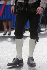 A visitor wears traditional Lederhosen trousers at a festival presenting Austria's Styria province in Vienna