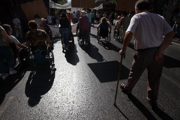 People with disabilities participate in a rally against new austerity measures in Athens
