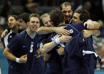 Argentina's players celebrate after defeating Slovakia in their Group D match at Men's Handball World Championship in Gothenburg